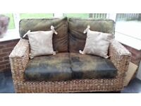 2 Seater conservatory sofa, distressed leather effect cushions, very solid construction, banana leaf