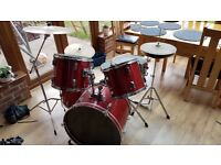 Full size beginner's drum kit with practice pads