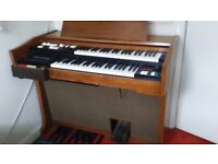 Vintage Lowrey Organ in great working order including a Piano Storage Stool and Music books