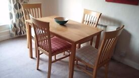 Solid wood dining table and 4 John Lewis chairs with padded seats
