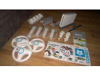 Nintendo Wii Console, 4 controllers, 2 nun chucks, 5 games – Mario Kart and 3 official wheels