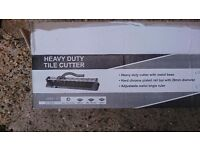 Heavy duty tile cutter used for one job only. In good condition kept in original box.