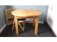 Extendable Dining table. Feel free to view.