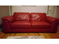 Lovely red leather sofa, chair & storage foot stool in good condition