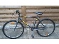 Fast mountain bike with all gears and brakes working. It has a slight touring bike riding position.