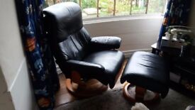 Ekornes Stressless black leather armchair and stool