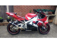 yamaha yzf r1 in red white and black with custom seat