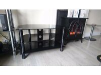 Black glass tv stand. Up to 50 inch
