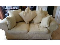 Sunshine yellow three seater and two seater settee