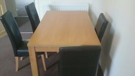 Pine dining room table and four leather chairs
