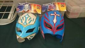 A pair of wrestling masks brand new