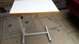 Two adjustable over lap/bed tables. One larger one and one smaller collapsable lightweight one.
