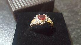 9ct. Gold created ruby and diamond accent heart ring.Size:M