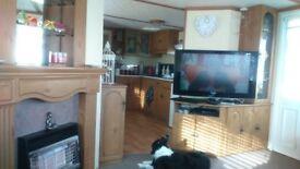 BARGAIN BREAKS ... SANDYLANDS ... 3 BEDROOM FAMILY CARAVAN ...£75. SECURITY..