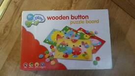 Wooden buttons puzzle board
