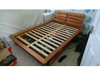 Standard size UK pine double bed, with floating side shelves and under bed draws.