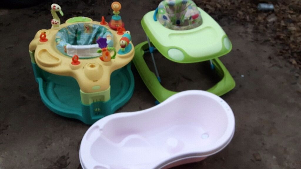 Baby walker, playcentre and bath.