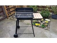 Trolley barbecue with cast iron body with air blowing