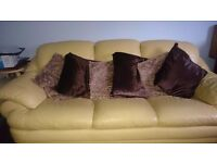 2 three seater yellow leather sofas for sale
