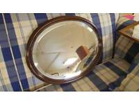 Lovely Oval Dark Wood Mirror