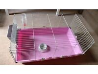 Pink cage for guinea pigs or young rabbit