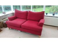 Red two seater sofa, great condition