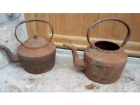 Pair of old cast iron kettles
