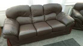 3 and 2 seater brown leather sofas. £250 ONO