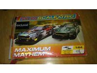 3 x micro scalextric sets- transformers / aston martin db9 /simpsons