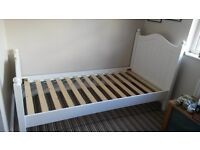 Single wooden frame bed