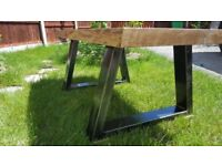 Industrial oak coffee table with steel legs and LIQUID METAL poured into the cracks.