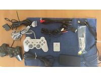 2 Playstation Controllers and PS1 /2 Games and Memory Card
