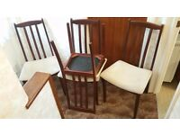 Four dining chairs for sale , dark wood with cream seating.