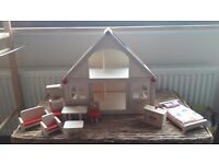 Wooden dolls house with set of furniture