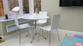 White round table with four chairs