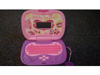Toddlers handbag style lap top toy.