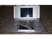 Immaculate Silver Nintendo DS Lite with 8 games and charger