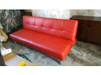 Red faux leather sofa bed