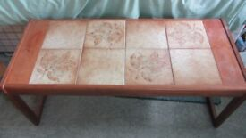 Sturdy wooden coffee table with attractive inset tiles on the top.