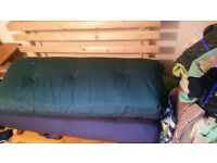 Futon - never used. Great for spare room.