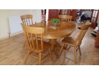 Solid pine table and 4 very solid chairs. Delivery can be arranged if required.