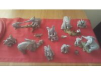 Loads of TUSKERS collectible elephants