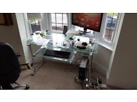 Glass and chrome computer desk. With sliding key board tray