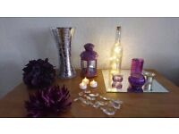 Various wedding decorations and centerpieces in purple and silver