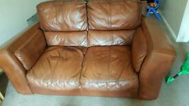 2 x two seater brown leather sofas low seat, very sturdy