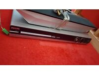 Phillips Dvd player/music system with surround sound speakers.