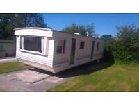 Cheap static caravan for sale on family owned park.