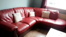 Red italian real leather corner sofa , good condition selling due to moving.