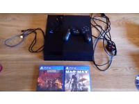Playstation 4 with all cables and 2 games