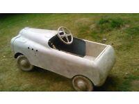 Vintage original child's toy peddle car. Unrestored lovely condition